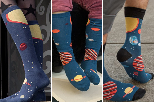 image showing three versions of the same socks covered in planets and stars.