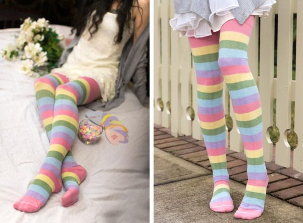Two images side by side of a person wearing long thigh highs striped in a pastel rainbow.